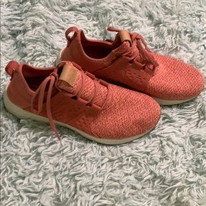 Coral New Balance shoes